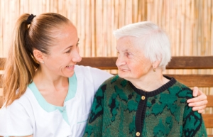 elderly woman with a caregiver
